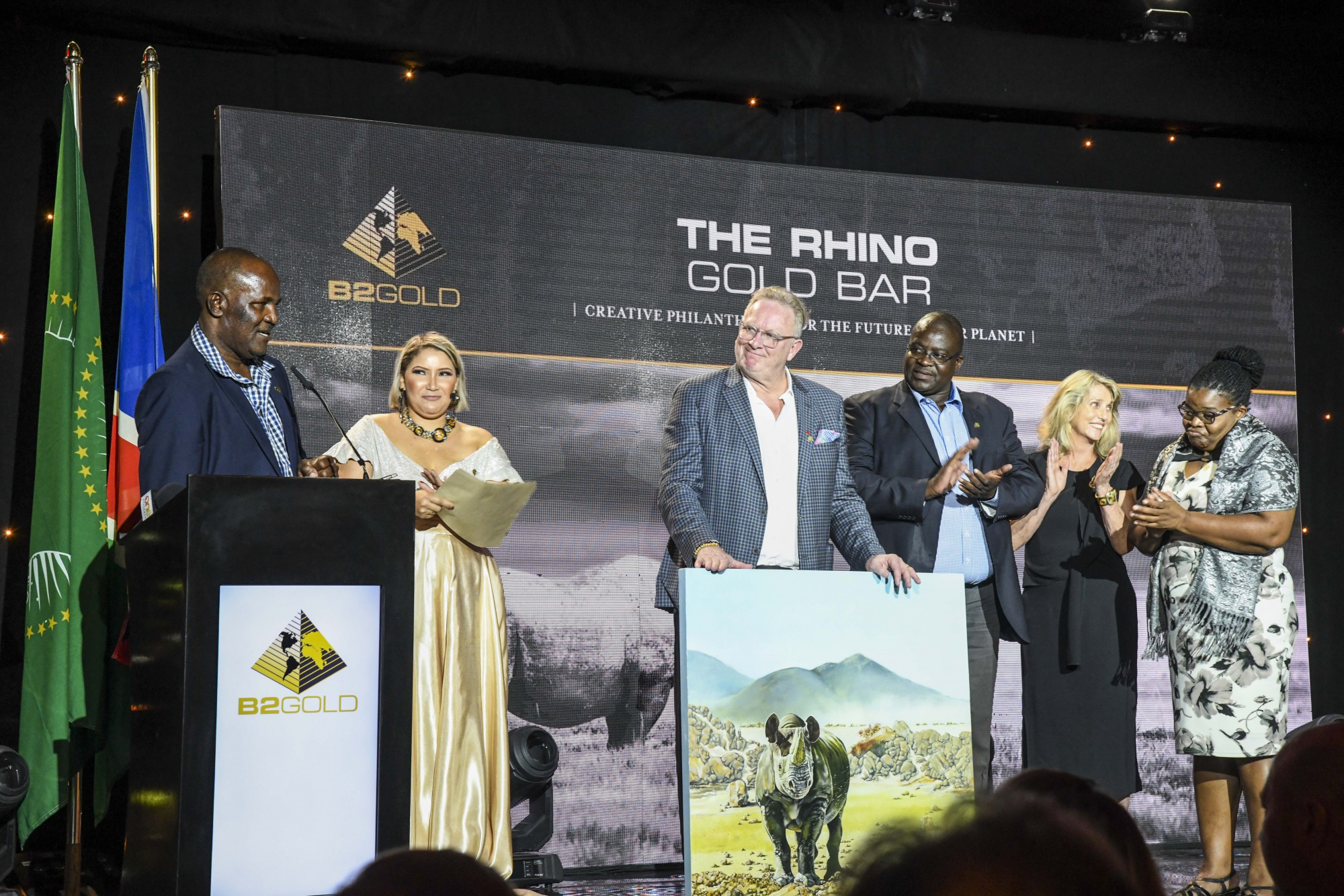 "Members from Save the Rhino Trust ""SRT"" and Integrated Rural Development and Nature Conservation ""IRDNC"" presenting a token of their appreciation to Clive Johnson (President, CEO & Director, B2Gold Corp.).  From left to right: Simson Uri-Khob (CEO, SRT), Clive Johnson, John Kasaona (Executive Director, IRDNC), Ginger Mauney (Director, SRT) and Maxi Louis (Board of Trustees Chairperson, SRT)"